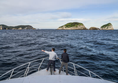 Guests-admire-the-Breaksea-Islands-from-the-bow-of-Odalisque