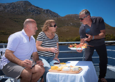Guests-enjoying-freshly-caught-seafood-prepared-by-the-onboard-chef