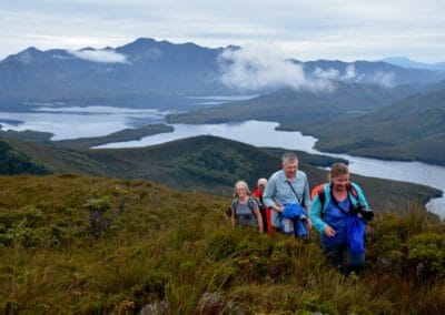Guests hiking up Bathurst Harbour mountains